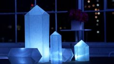 These geo-shaped lanterns will light up your next dinner party and are simple to create with a paper, a template and double-sided tape.  Fold each side point down to meet the bottom point.  Lift the top layer of the bottom point, and tuck both side points in, bringing them down to meet the bottom point (on the bottom layer).