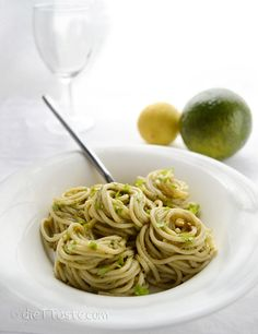 Avocado Pesto Pasta | This simple recipe is made with avocado, pasta, and Italian pesto. Creamy pureed avocado is blended with olive oil, lemon juice and bold,  flavor-packed pine nut-basil pesto. It can be served sprinkled with grated Parmesan cheese (optional).
