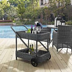 Perfect for entertaining in the backyard, the Summon Outdoor Patio Beverage Cart from Modway offers ample room for your favorite drinks, wheels and a handle, as well as a handsome rattan weave that resists water and UV rays.