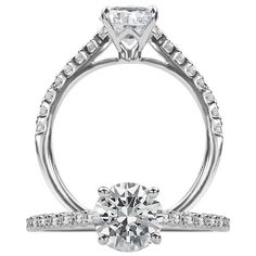 Classic diamond engagement ring featuring a prong set round cut center stone…