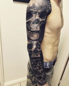 Guys sleeve with four skulls the top one wears a crown of thorns ...