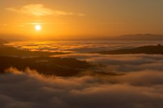 Sunrise Above Clouds - Sunrise above clouds (fog sea) at the end of the past year 2015 in west Slovenia region. View from tower of Gonjače (Slovenia) toward Vipava valley with mountain Nanos (Slovenia).