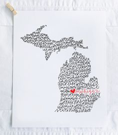 All the things that make Michigan great drawn in the shape of the state. Take closer look to see the names of cities, nicknames, parks,