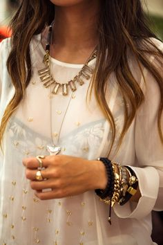 Layer a sheer shirt over patterned cami then pile on the accessories!