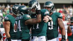 Ryan Mathews #24 of the Philadelphia Eagles is congratulated by quarterback Carson Wentz #11 after scoring a touchdown against the Cleveland Browns during the fourth quarter at Lincoln Financial Field on September 11, 2016 in Philadelphia, Pennsylvania. The Eagles defeated the Browns 29-10.