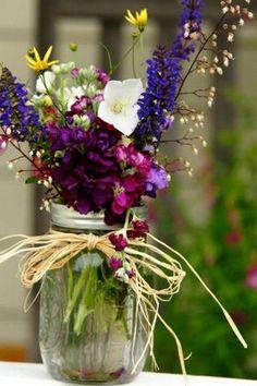 mason jar with flowers wedding centerpiece / http://www.himisspuff.com/rustic-mason-jar-wedding-ideas/