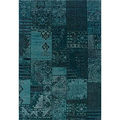 over-dyed rug in iwashed shades of teal and grey
