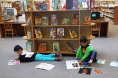 Just hangin' around the library enjoying our new Graphic Novels collection...
