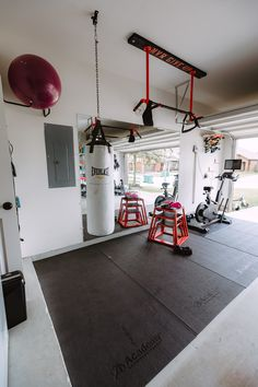 Half Garage gym on a budget with floor mats, and mirrors!