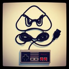 Nintendo Genius. This would be a super cute tattoo But I'd do the shape of a one-up mushroom or the coon  feather and the Super NES remote