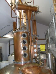 A still named Tracey. The column (the part of the still with four circular windows) has filters which help to purify the alcohol. Diagram of distillation process at Rogue.