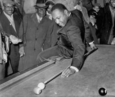 MLK plays pool.