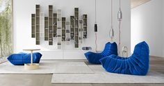 Blue Togo Sofa Among Modern Design Decorated under Bright Living Room Interior With Wall Shelving Furniture