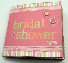 """Put on the invitations, or contact your guests before the event, and ask that they each bring to the shower a picture of herself with the bride. Get an empty scrapbook and decorate the cover so that it reads something like """"BRIDE'S NAME & Friends Forever"""", or """"With Love To BRIDE'S NAME""""."""