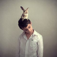 excuse me young sir, are you aware that you have a rabbit on your head.