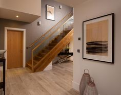 A touch of colour adds a contemporary twist to traditional natural solid woods. providing a bold accent to a hallway strikes the balance between traditional and cutting edge Modern Spaces, New Homes For Sale, Staircases, Luxury Living, Contemporary Style, Modern Architecture, Solid Wood, Color Schemes, Woods