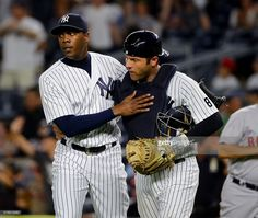 Aroldis Chapman #54 and Austin Romine #27 of the New York Yankees celebrate the 3-1 win over the Boston Red Sox at Yankee Stadium on July 17, 2016 in the Bronx borough of New York City.
