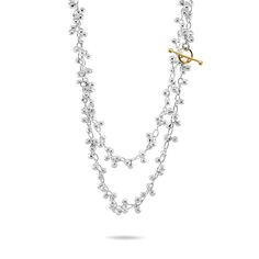 This stunning sterling silver beaded necklace is finished with a contrasting 14k yellow gold toggle clasp. The clasp looks beautiful worn to the front as a decorative element.