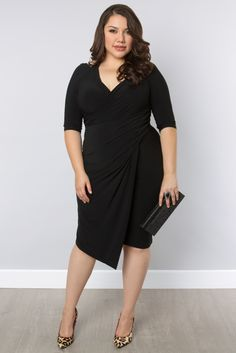 Holy hotness! Our plus size Foxfire Faux Wrap Dress has a halter top neckline and a deep V-back, giving you style that is sure to be noticed! Browse our entire collection of made in the USA dresses, tops and more at www.kiyonna.com