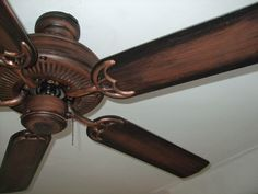 Ceiling fans are a hot topic on Apartment Therapy. For such a common home item, it can be tough finding a style you can live with. One solution I came across was to antique a store bought fan for an industrial-age look. Ceiling Fan Redo, Painting Ceiling Fans, Ceiling Fan Makeover, Ceiling Decor, Rustic Lighting, Home Lighting, Antique Ceiling Fans, Painting Hardware, Barn Parties