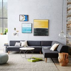 Our Retro Tillary 8-Piece Sectional is lofted on angled solid oak legs in an Almond finish for a mid-century look. Its weighted, movable back cushions let it seamlessly swing from sofa to chaise to sectional. Each piece is crafted in the USA with hand-built frames and cushions and hand-finished upholstery.