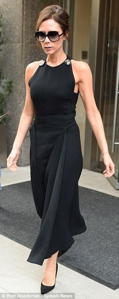 VB Style star: The mother-of-four, who owns her own global fashion empire, looked effortlessly chic in a sleeveless black dress, complete with a tight bodice and flared hemline - September 28, 2915