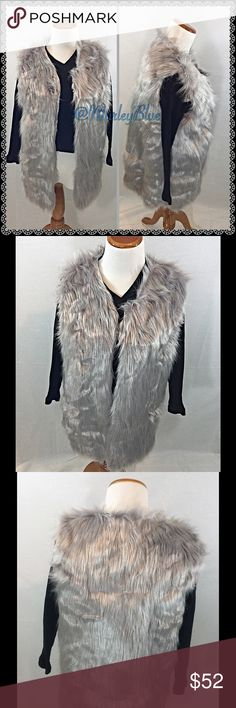 🆕Amazing Silver-Grey Long Faux Fur Vest So on-trend for the season! Beautiful faux fur vest in a silvery grey color. Has matching satin lining. Eye- hooks on inside if you choose to wear vest closed...looks great both ways.  True to size. Size chart included 4th pic. Photos are of actual vest. Very nice quality.  About 26 inches long. 100% polyester. Feel free to ask questions. Price is firm. 20% off 2 or more items from my closet😊 Jackets & Coats Vests