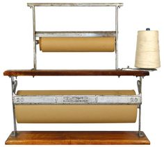 Gift wrapping station..... would LOVE to have the space for it! Love this vintage paper and twine holder.