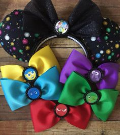 Interchangeable inside out pixar movie inspired mouse ears with 5 bows