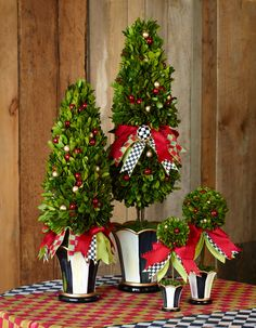 Our Holiday Topiaries are made from preserved boxwood and embellished with signature Orchard Check and Courtly Check ribbons.