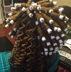 Bantu knots out with rods on dreads.