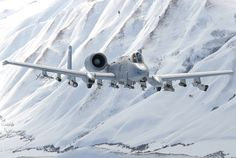 A USAF Thunderbolt (Warthog) flies through a snowy mountain valley. Military Jets, Military Aircraft, Fighter Aircraft, Fighter Jets, A10 Warthog, Jet Plane, War Machine, Aviation Art, Military Vehicles