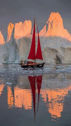 Sailboat in front of an iceberg | Re-pinned by Diana Darr Photography