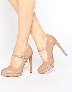 Chrissie nude patent mary jane shoes by Faith. Heels by Faith Leather-look upper Patent finish Pin buckle fastening Almond toe Platform sole Hig...