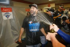 Toronto Blue Jays' Kevin Pillar reacts as a teammate sprays him with champagne after the second baseball game of a doubleheader against the Baltimore Orioles, Wednesday, Sept. 30, 2015, in Baltimore. (AP / Patrick Semansky)