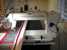 Viking 18x8 Long Arm Quilting Machine  Wish I had the money for one!  Me too!!!