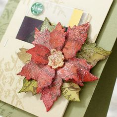 Shari Carroll: Tim Holtz Poinsettia Die http://www.simonsaysstampblog.com/blog/poinsettia-gift-card-with-shari/