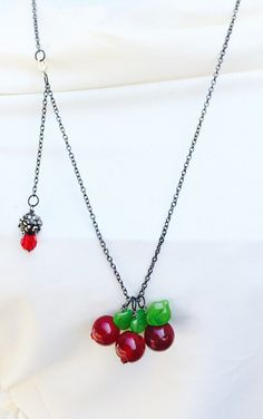 I like the idea of a charm hanging from the back of the necklace! Red cherry charm necklace rockabilly jewelry retro by crushedcameo