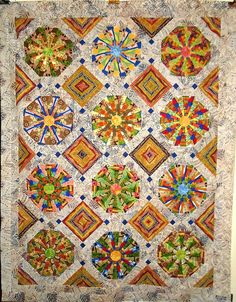 T-African Medley | Flickr - Photo Sharing! notice how the alternate blocks were cut from the stripe