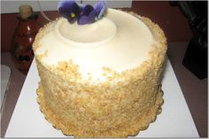 Moist, spicy carrot cake with a light, sweet cream cheese frosting with crushed walnuts on the rim of the cake