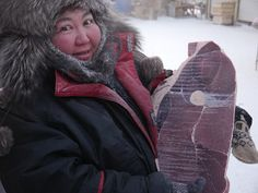 This is a steak which traveled from Yakutsk all the way to Arkah with us, a giant steak. Frozen of course, bought at the coldest outdoor fish-and meat market in the world. -49 degrees Celsius the day we bought it and this lady, she had spent 8 hours outdoors selling steaks....