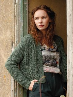 Knit this womens cable cardigan with moss stitch sleeves from Wintertide. A design by Martin Storey using Renew, a fabulous tweedy yarn made from 93% recycled wool and 7% polyamide.