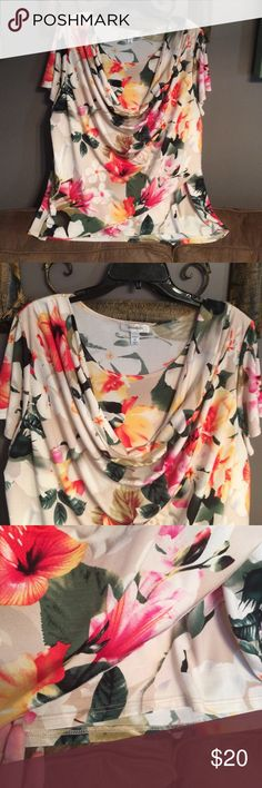 Dress Barn floral blouse This blouse is so figure flattering! A built in cami with cowl neck and a wrap around style at the bottom. Machine washable! Very stretchy and comfortable! Dress Barn Tops Blouses