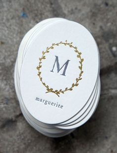 We swoon over these oval letterpress business cards.