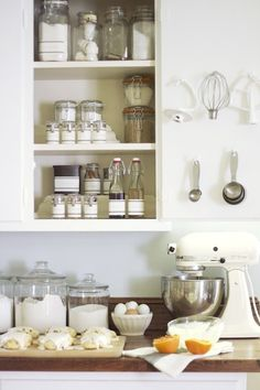 KITCHEN--  Keep in organized, well laid out and decant items into farmhouse style containers.  Baking organization
