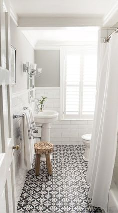 Tile - black and white for shower floor Bathroom with white subway tile and patterned encaustic floor tiles, designed by Vintage Scout Interiors, via /sarahsarna/.