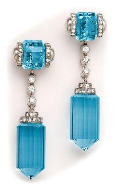 Art Deco barrel-cut aquamarine, diamond and platinum long drop earrings.