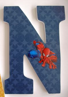 Custom Decorated Wooden Letters SUPERHERO THEME --- Check out her site, TONS are covered wooden letters --- Lots of themes