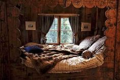 Imagine all of the cozy cuddles reading laughing tea-drinking and lovings that can happen there such a COZY cabin bedroom.