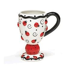 I have this mug...I love it! It makes me smile on my bad days. :)